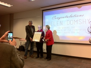 Helen Domshy being presented with the Council of the Federation Literacy Award, with MLAs Mike Morris and Shirley Bond.